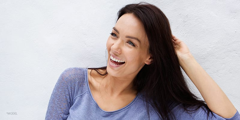 Model In Blue Blouse Laughing
