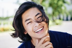 Young Asian Male Smiling Outdoors