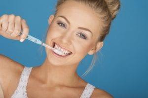 Blond Model Brushing Teeth Copy