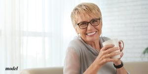 Blod older woman drinking coffee